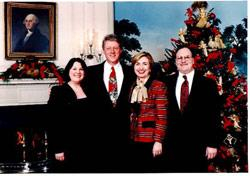 Nancy, President and Hillary Clinton, and Rev. Richard M. Stower at a White House holiday party.