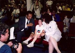 1988 Presidential candidate, Rev. Jesse Jackson, Nancy's son, Jonathan (age 8) and Nancy (sporting a Biden for President button and explaining why to Rev. Jackson)